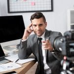 real estate agent recording video in office